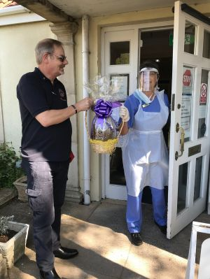 Presenting an Easter Egg to a Care Home in Cheddar