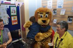 Brian the Lion gets a big hug