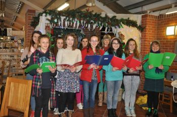 Cheddar Valley Voices perform prior to Tree of Light