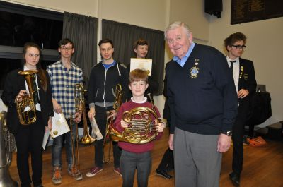 Lion Glyn John and member of Cheddar Valley Music Club with the French Horn presented to them at their Annual Concert