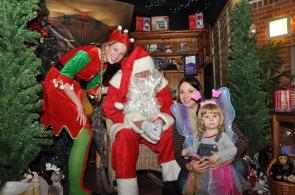 Father Chrismas and his Elf met a beautiful fairy and mum