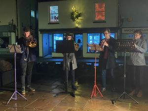 QUARTET PLAYING CHRISTMAS CAROLS FOR TREE OF LIGHT