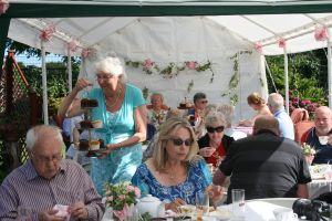 Members tuck in to afternoon tea